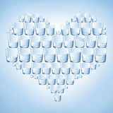 Glasses of water shaped with heart. Healthy Stock Images
