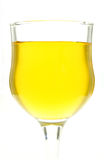 Glasses of water a yellow color. On white background Royalty Free Stock Photo