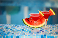 Glasses of watermelon cocktail near the pool Stock Photo