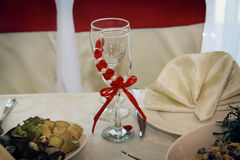 Glasses in wedding clothes Royalty Free Stock Image