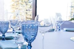 Glasses on the wedding table on a light background stock images
