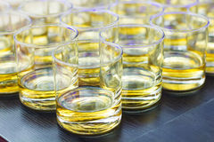 Glasses of whiskey stock images