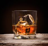 Glasses of whiskey with ice cubes Stock Photo