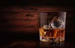 Glasses of whiskey with ice cubes Stock Images