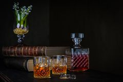 Glasses of whiskey with ice on a dark background stock images