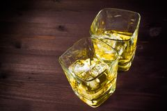 Glasses of whiskey on old wood table background Royalty Free Stock Photos