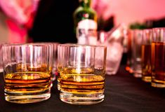 Glasses of whiskey at a party stock photography