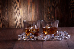 Glasses of whiskey on wood background Stock Photos
