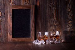 Glasses of whiskey on wood background. Whiteboards Royalty Free Stock Photography