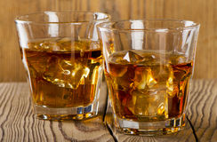 Glasses of whiskey on wooden background Stock Images