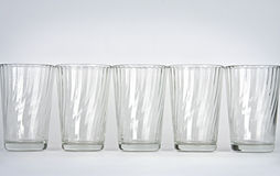 Glasses on a white background. Five empty glasses on a white background Royalty Free Stock Image