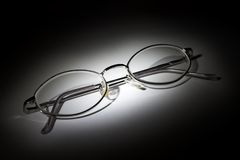 Glasses on white background in the darkness
