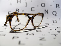 Glasses. On a white background with letters stock photography