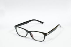 Glasses on the white book. Picture of black glasses on a white book Stock Image