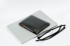 Glasses on the white book. royalty free stock image