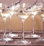 Glasses of with white champagne decorated with lavender Stock Photo