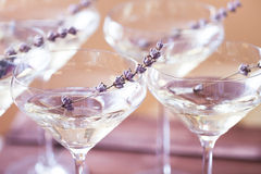 Glasses of with white champagne decorated with lavender Stock Images