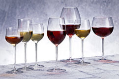 Glasses of white and red wine Stock Photos