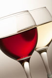 Glasses of white and red wine Stock Images