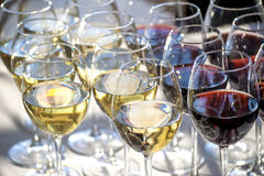 Glasses with white and red wine close-up Stock Images