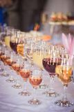 Glasses with white and red wine. Close-up before party in cafe Royalty Free Stock Photos