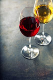 Glasses of white and red wine Royalty Free Stock Images