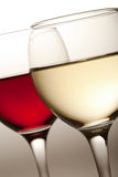 Glasses of white and red wine isolated Royalty Free Stock Image