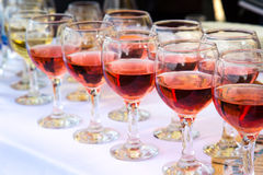 Glasses of white and red wine Stock Photo