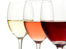 Glasses of white, rose and red wine. White, rose and red wine in glasses on white background Stock Image