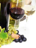Glasses of white and rose wine and grapes over white Royalty Free Stock Photography