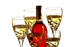 Glasses with white wine around bottle of red wine Stock Photography
