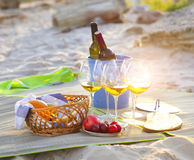 Glasses of the white wine on the beach picnic Stock Photo