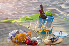 Glasses of the white wine on the beach,. Picnic theme stock image
