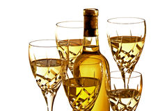 Glasses of white wine with bottle Stock Image