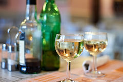 Glasses of white wine on cafe Stock Images