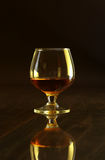 Glasses with white wine and cognac or whisky on mirror table. Celebrities composition. Stock Images