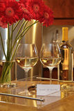 Glasses of white wine with gerbera daisies royalty free stock photos