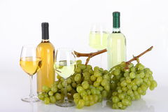 Glasses of white wine and grapes Stock Image