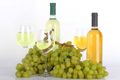 Glasses of white wine and grapes Royalty Free Stock Photo