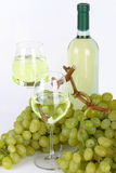 Glasses of white wine and grapes Royalty Free Stock Image