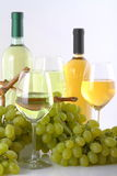 Glasses of white wine with white grapes. On white background Royalty Free Stock Photography