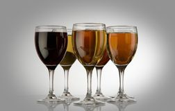Glasses with wine. Five glasses of different wine Royalty Free Stock Images