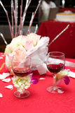 Two glasses of red wine at the wedding. Glasses wine on the red cloth at a Wedding Stock Images