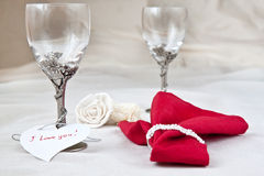Glasses for wine. Tow beautiful glasses with red napkin, heart and rose Stock Photography