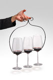Glasses of wine. Wine glasses on metal holder Stock Photos