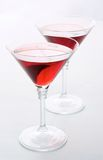 Glasses with wine. Two martini glasses with red wine over white background Royalty Free Stock Photos