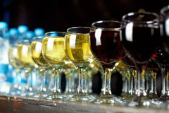 Glasses with wine. Glasses with red and white wine Stock Images