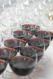 Glasses with wine. Some glasses with wine, some empty some filled royalty free stock photos