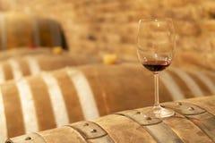Glasses of wine on barrel, Szekszard, Hungary. Drink, winery, red, background, beverage, bottle, alcohol, cask, wineglass, wood, wooden, liquid, merlot royalty free stock image
