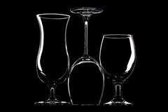 Glasses for wine, beer and cocktail on black background Stock Images